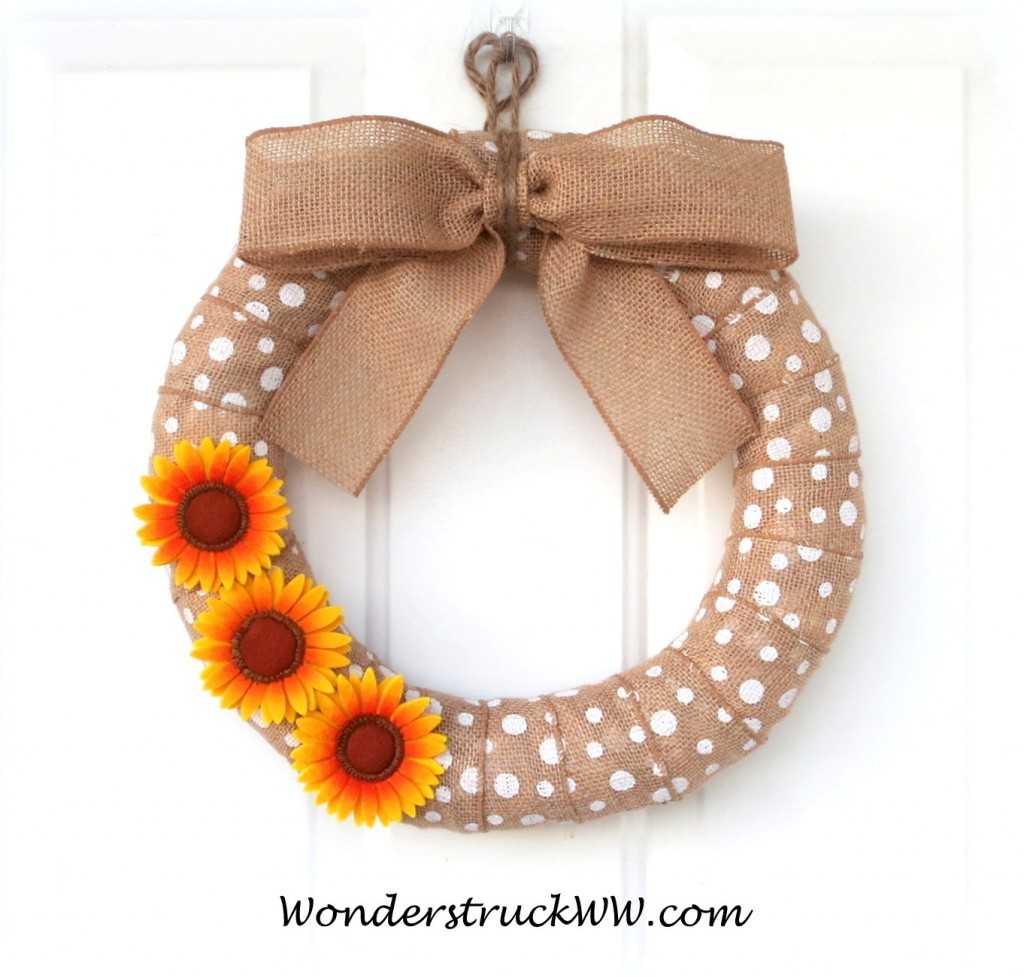 Winner can choose a 12-Inch Wreath with 2 sunflowers or a 14-Inch with 3 sunflowers (as shown above)